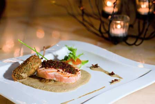 Dish of the year: Grilled salmon crusted in ancho chili with sauce of pumpkin seed and roasted tomato, by Chef José Manuel Gordián Martínez of Grand Velas Riviera Nayarit.